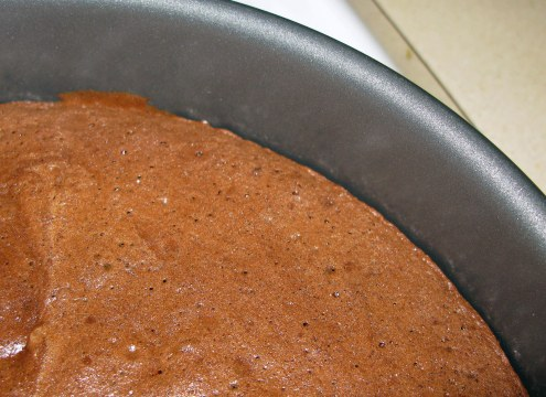 Coffee Chocolate Cake Pulling Away from Edge of Pan